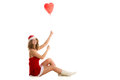 Girl sitting with balloon santa heart shaped Royalty Free Stock Photography