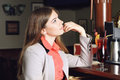 Girl sitting at the bar in expects order Royalty Free Stock Photos