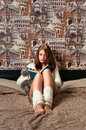 Girl sitting in bedroom and reading Royalty Free Stock Photography