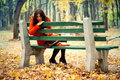 Girl sitting on bench Royalty Free Stock Photos
