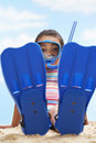 Girl sitting in flippers and snorkeling mask full length portrait of on beach Stock Photo