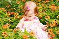 Girl Sitting In Flowers