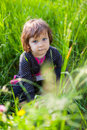 Girl sitting in grass beautiful caucasian Stock Photo