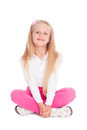 Girl sitting in the lotus position little six years Royalty Free Stock Photos