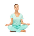 Girl sitting in lotus position and meditating picture of Royalty Free Stock Images