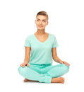 Girl sitting in lotus position and meditating picture of Stock Image