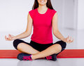 Girl sitting in lotus position and meditating sport yoga concept Royalty Free Stock Images