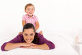 Girl sitting on mother 's back Royalty Free Stock Image