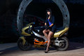 Girl sitting on a motorcycle at night biker beautiful black haired woman in short skirt sports bike female biker Stock Photography