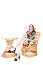 Girl sitting outdoor wicker furniture chair table Royalty Free Stock Photo