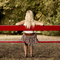 Girl sitting on a park bench rear view of beautiful Stock Photo