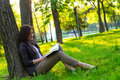 Girl sitting park read book summer Royalty Free Stock Photography