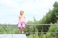 Girl sitting on railings smiling child barefoot metal Stock Image