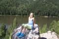 Girl sitting on a rock and enjoying river view young Royalty Free Stock Photo