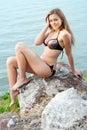 Girl  sitting on the rocks Stock Image