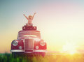 Girl sitting on roof of car toward adventure relaxing and enjoying road trip happy child vintage Royalty Free Stock Photo
