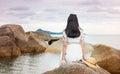 Girl sitting on the seaside rocks Royalty Free Stock Photo