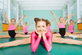 Girl sitting in splits during gymnastics class Royalty Free Stock Photo