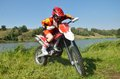 Girl sitting on a sport bike for motocross Stock Photos