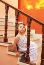 Girl sitting on the stairs Stock Photo