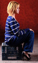 Girl sitting on the stool Royalty Free Stock Photos