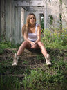 Girl sitting on the stoop of abandoned house Stock Images