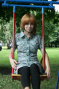 Girl sitting on swing Stock Images