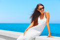 Girl sitting on white pier. Sea View Royalty Free Stock Photo