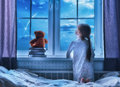 Girl Sitting At The Window