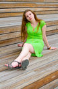 Girl sitting on wooden stairs Royalty Free Stock Photo