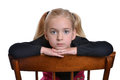 Girl sitting young on chair Stock Photography