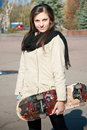 Girl with skateboard on sunny day Royalty Free Stock Photo