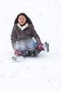 Girl sledging in winter in denmark Royalty Free Stock Photos