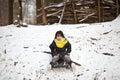 Girl sledging in winter in denmark Stock Images