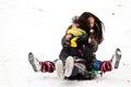 Girl sledging in winter in denmark Royalty Free Stock Image