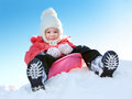 Girl with sleds on the hill against blue sky Royalty Free Stock Image