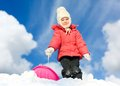 Girl with sleds on the hill against blue sky Stock Photos