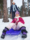 Girl on sleds in snow Royalty Free Stock Image