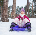 Girl on sleds in snow Royalty Free Stock Photo