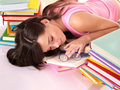 Girl sleep on pile of book. Stock Photo