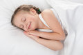 Girl sleep in white bed cheerful Royalty Free Stock Images