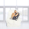Girl sleeping in arm-chair Stock Images