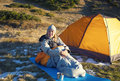 Girl in a sleeping bag the basking at dawn Stock Photography