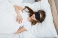 Girl Sleeping On Bed With Sleep Mask Royalty Free Stock Photo