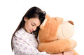 Girl sleeping with a big teddy bear beautiful falling asleep holding Stock Images