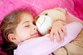 Girl sleeping with teddy bear Stock Image
