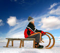 Girl on a sleigh Stock Photography