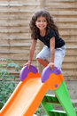 Girl and slide Royalty Free Stock Images