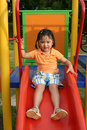 Girl on the slides Royalty Free Stock Image