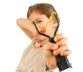 Girl with slingshot aim to camera Royalty Free Stock Photo